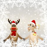 Merry goat in a christmas cap and elk Royalty Free Stock Images