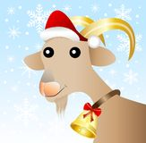 Merry goat  in a christmas cap Royalty Free Stock Images