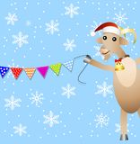 Merry goat and festive garland Stock Photography