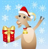 Merry goat with a gift on a blue background with snowflakes Stock Image
