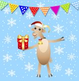Merry goat with a gift and festive garland Stock Photography