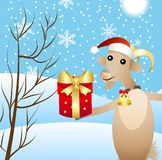 Merry goat with a gift Royalty Free Stock Images