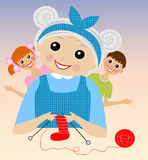 A merry grandmother binds socks for grandchildren Royalty Free Stock Image