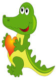 Merry green crocodile keeps heart Royalty Free Stock Images