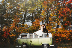 Merry happy young couple on the background fabulous autumn fores Royalty Free Stock Photo