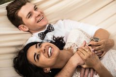 Merry happy young couple hugging in a hammock. Closeup. Merry happy young couple hugging in a hammock. Close-up royalty free stock image