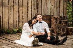 Merry happy young couple sitting on the wooden floor. Closeup. Stock Photo