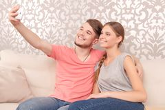 Merry husband holding mobile phone Royalty Free Stock Photography