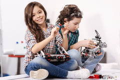 Merry little children using gadgets and devices at home Stock Photos