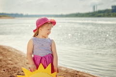 Merry little girl posing on river bank, close-up Stock Photography