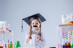 Merry little scientist posing with fake mustache Stock Photo