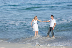 Merry lovers having fun at the seaside Royalty Free Stock Images