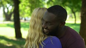 Merry male embracing woman, mixed raced happy couple, interracial relationship stock video footage