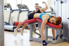 Merry man and woman tired of training in gym Royalty Free Stock Images
