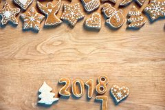 Merry X-mas! Homemade cookies on wooden background. Royalty Free Stock Photo
