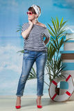 Merry middle-aged model posing in sailor's style Stock Images