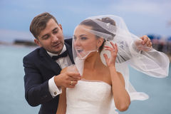 Merry newlyweds outdoor. Royalty Free Stock Images