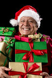 Merry Old Man With Broad Grin Loaded With Gifts Royalty Free Stock Photo