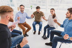 Merry people sitting in circle Stock Image