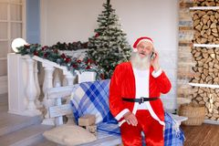 Merry phone call from Santa Claus. Requesting free personalised phone call from Santa Claus. Hilarious Father Christmas speaking with kids about presents stock photos