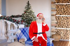 Merry phone call from Santa Claus. Requesting free personalised phone call from Santa Claus. Hilarious Father Christmas speaking with kids about presents royalty free stock photography