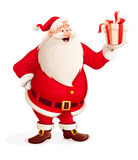 Merry Santa Claus with Christmas gift in hand Stock Images