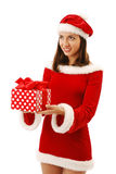 Merry Santa offering a christmas present. Royalty Free Stock Photos