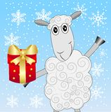 Merry sheep with a gift on a blue background with snowflakes Royalty Free Stock Photos