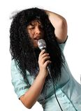 Merry singer. A woman in a wig singing a merry song Royalty Free Stock Photo