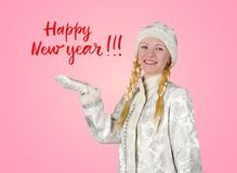 Snow maiden on a pink background with a congratulatory inscription royalty free stock photo