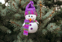 Merry snowman on the background of Christmas tree close-up Stock Photos