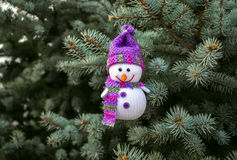 Merry snowman on the background of Christmas tree Stock Photography