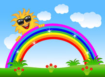 Merry sun peeks out from a rainbow Stock Photography