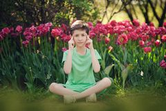 Portrait of a beautiful boy in a spring park. stock photo