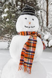 Merry White Snowman with a scarf and a hat Stock Photo