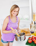 Merry woman cooking spaghetti at home Royalty Free Stock Image