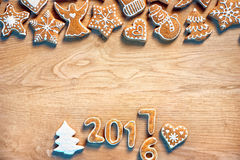 Merry X-mas! Homemade cookies on wooden background. Royalty Free Stock Photography