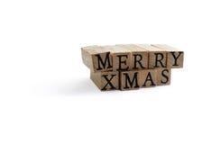 Merry Xmas. Wooden blocks spelling Merry Xmas royalty free stock image