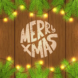 Merry Xmas card with Christmas lights on fir-tree branches Royalty Free Stock Photo