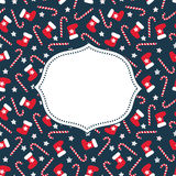 Merry Xmas card. Seamless Christmas pattern with xmas stocking, stars and candy canes. With frame for your text. Happy New Year and Merry Xmas background Royalty Free Stock Image
