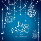 Merry Xmas with Christmas balls and stars on blue background stock illustration