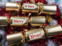 Merry Xmas ! Christmas Crackers. With red, gold, silver tinsel stock image