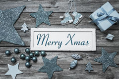 Merry Xmas greeting card with white wooden sign and blue turquoise decoration. Merry Xmas greeting card with white wooden sign and blue turquoise decoration royalty free stock image