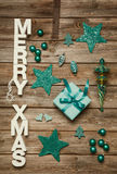 Merry Xmas greetings of wooden letters. Christmas decoration in Royalty Free Stock Image