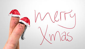 Merry Xmas hand writing with red mark on a transparent board and a Lovely Couple Fingers Royalty Free Stock Photos