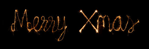 Merry Xmas made of sparkles firework at nigh Royalty Free Stock Photography