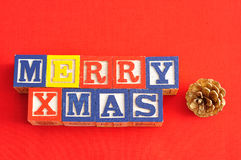 Merry Xmas spelled with Alphabet blocks and an acorn Royalty Free Stock Images