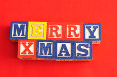 Merry Xmas spelled with Alphabet blocks Royalty Free Stock Images