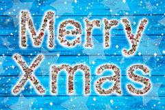 Merry Xmas wishes on blue wooden background and collage. Stock Photography