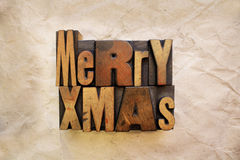 Merry Xmas. The words Merry Xmas written in vintage letterpress wood type stock photos